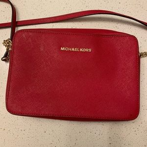 Red leather Micheal Kors crossbody purse